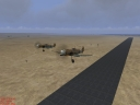 bf 109 f4 formation take off. note the desert skin